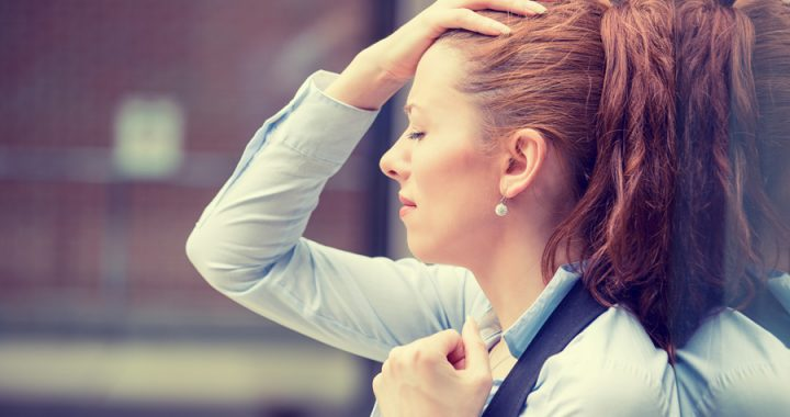 woman who is stressed holding her head