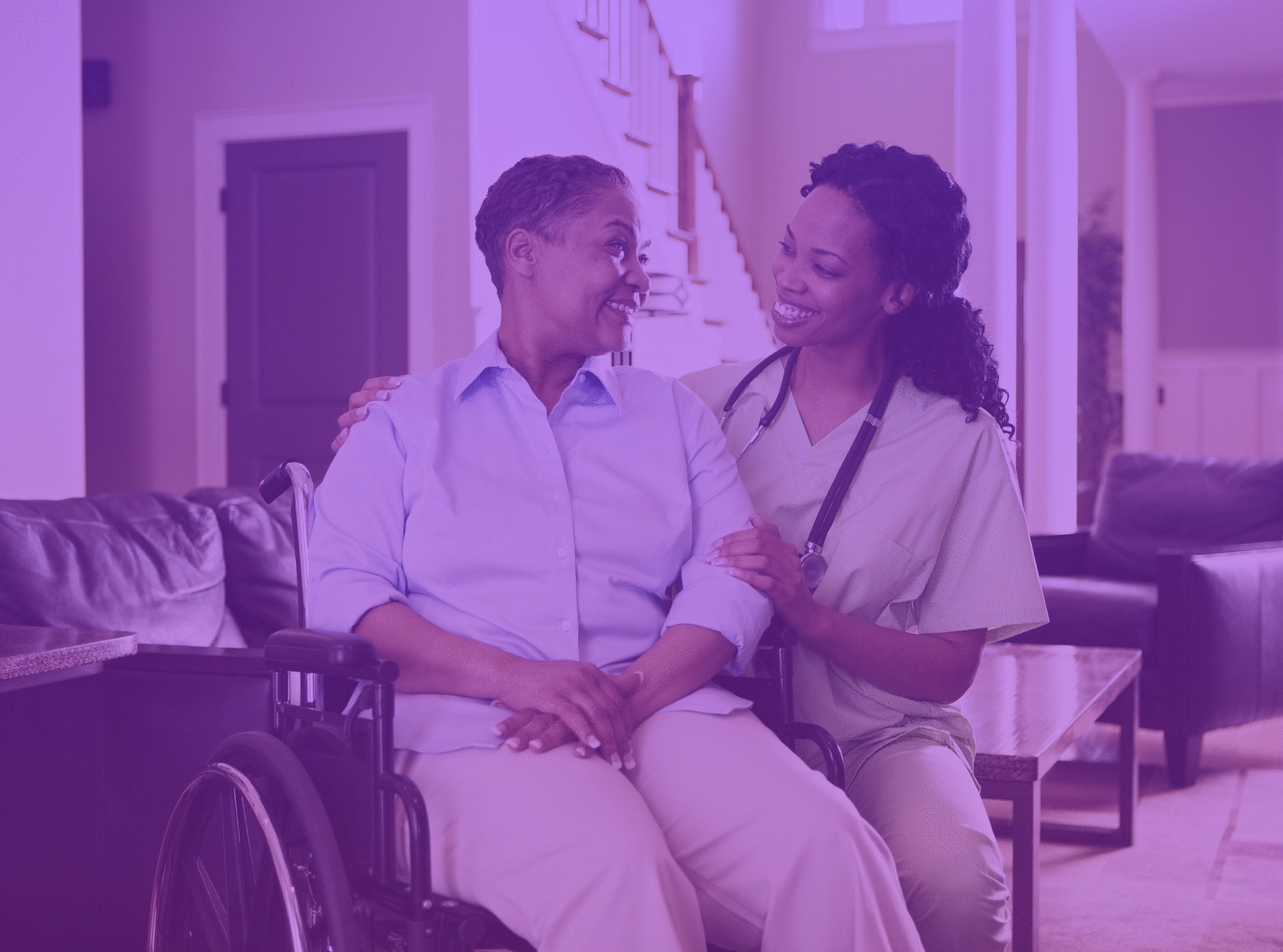 young nurse with an older woman in a wheelchair