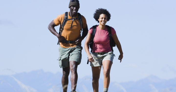man and woman hiking with backpacks